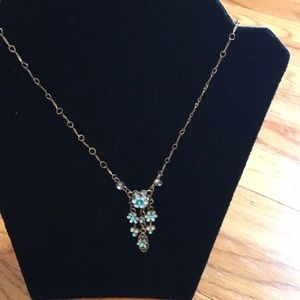 Silver necklace with blue flowers